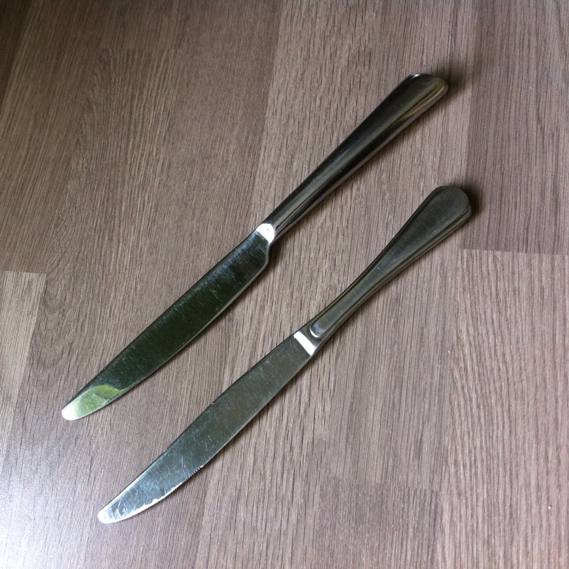 photo of two metal knives